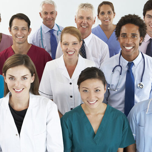 Portrait Of Group Of Workers In Medical Professions Smiling To Camera.